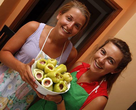 Girls posing with dolma stuffed peppers
